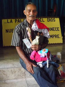 AN465 Grandfather of Maryam Judith Guzman receiving her gifts for her because they moved away and couldn't come on distribution day FHC884
