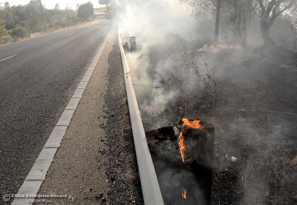 . The guard rail posts burn along Skyway after a fire that started near 2485 Honey Run Road and ran up Butte Creek Canyon toward lower Paradise, Calif. Monday Oct. 9, 2017. (Bill Husa -- Enterprise-Record)