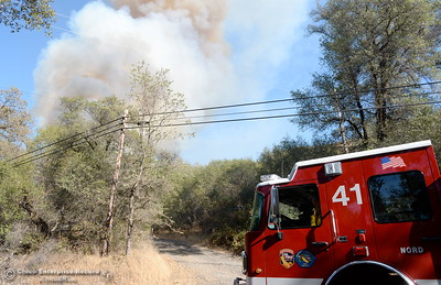 Engine 41 arrives on scene of a fire that started near 2485 Honey Run Road and ran up Butte Creek Canyon toward lower Paradise, Calif. Monday Oct. 9, 2017. (Bill Husa -- Enterprise-Record)