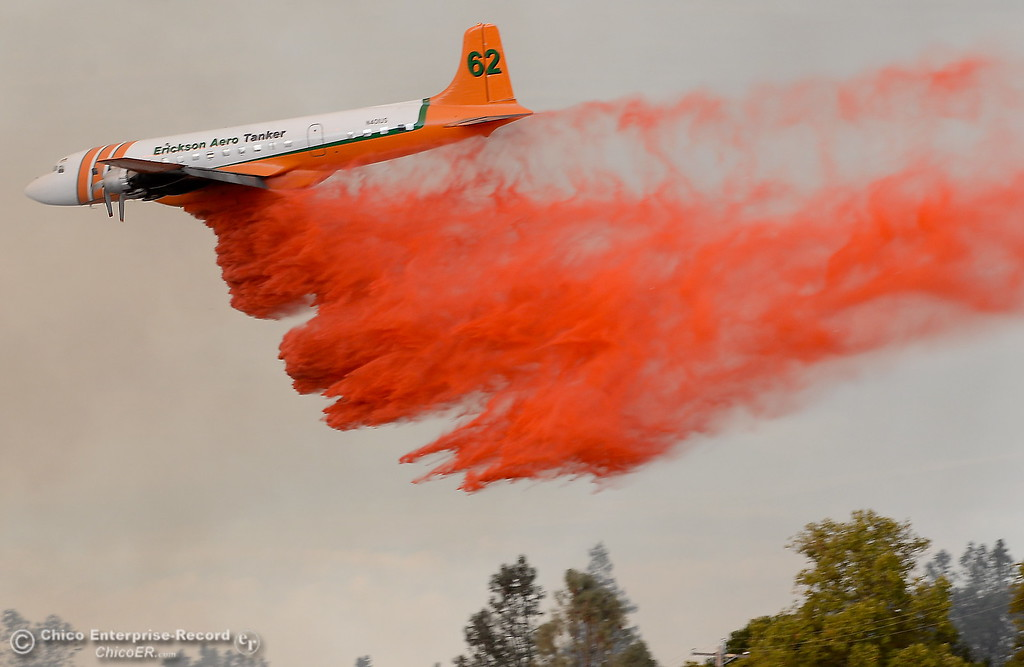 . Air tankers bring support to a fire that started near 2485 Honey Run Road and ran up Butte Creek Canyon toward lower Paradise, Calif. Monday Oct. 9, 2017. (Bill Husa -- Enterprise-Record)