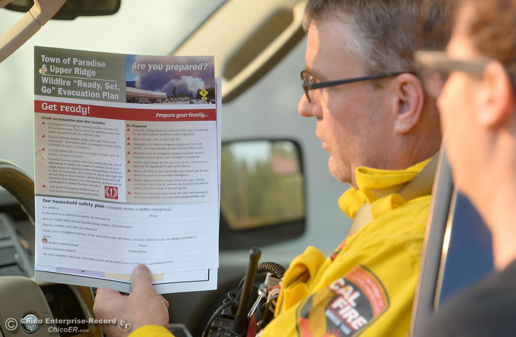 . CAL FIRE Butte County Division Chief David Hawkes talks with people as evacuation warnings are issued for lower Paradise, Calif. Monday Oct. 9, 2017. (Bill Husa -- Enterprise-Record)
