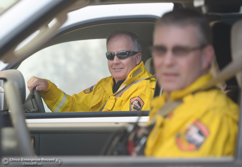 . Fire Chief Greg McFadden, left and CAL FIRE Butte County Division Chief David Hawkes talk with people as evacuation warnings are issued for lower Paradise, Calif. Monday Oct. 9, 2017. (Bill Husa -- Enterprise-Record)