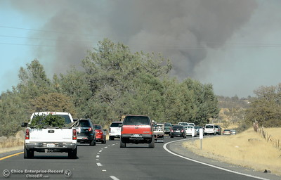 The last group of vehicles before the road closure make their way up Skyway after a fire that started near 2485 Honey Run Road and ran up Butte Creek Canyon toward lower Paradise, Calif. Monday Oct. 9, 2017. (Bill Husa -- Enterprise-Record)