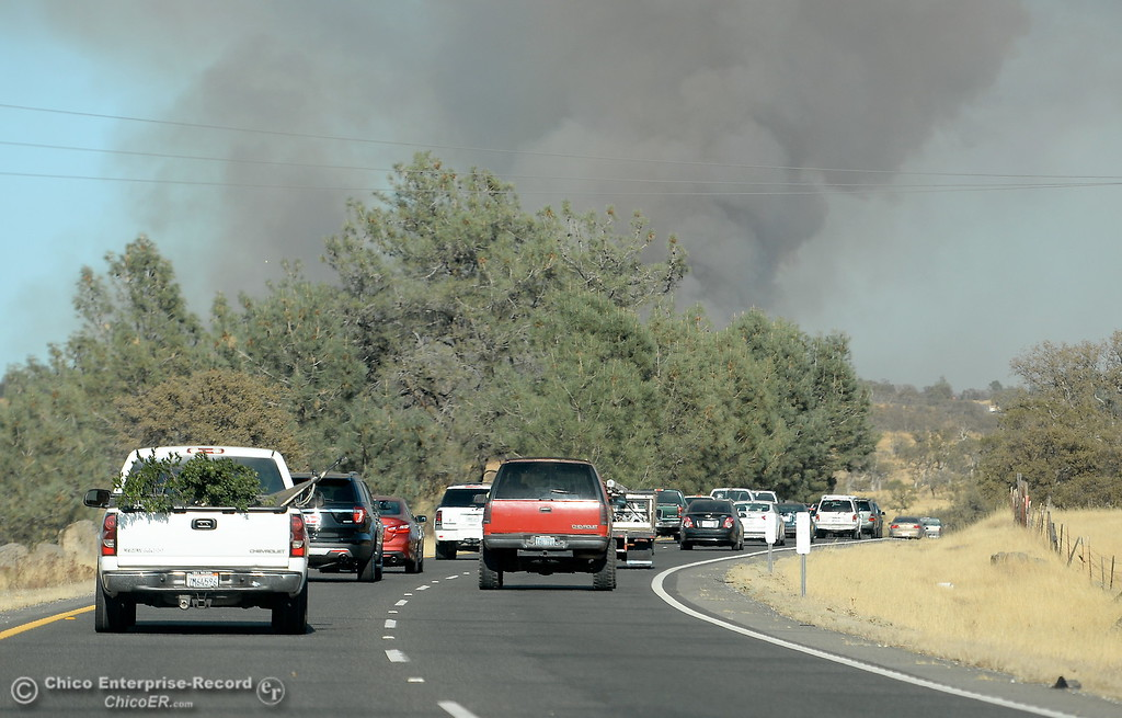 . The last group of vehicles before the road closure make their way up Skyway after a fire that started near 2485 Honey Run Road and ran up Butte Creek Canyon toward lower Paradise, Calif. Monday Oct. 9, 2017. (Bill Husa -- Enterprise-Record)