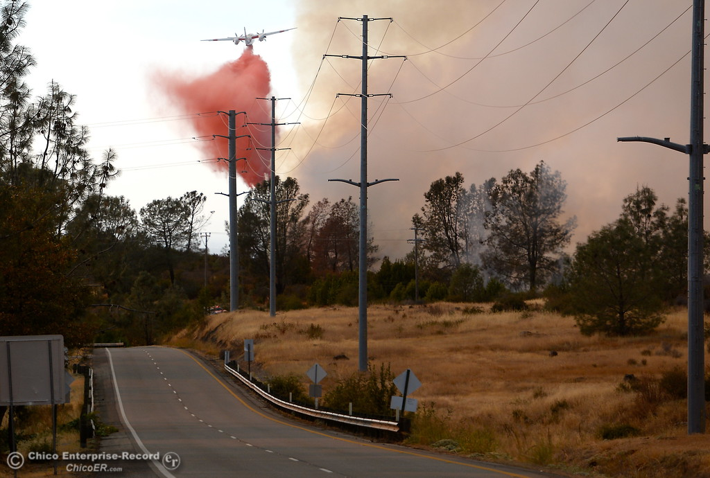 . An Air tanker makes a drop down lower on Skyway as a fire that started near 2485 Honey Run Road and ran up Butte Creek Canyon toward lower Paradise, Calif. Monday Oct. 9, 2017. (Bill Husa -- Enterprise-Record)