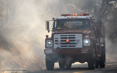 Firefighters arrive on scene in Butte Creek Canyon where a fire started near 2485 Honey Run Road and ran up Butte Creek Canyon toward lower Paradise, Calif. Monday Oct. 9, 2017. (Bill Husa -- Enterprise-Record)