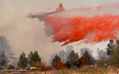 Air tankers bring support to a fire that started near 2485 Honey Run Road and ran up Butte Creek Canyon toward lower Paradise, Calif. Monday Oct. 9, 2017. (Bill Husa -- Enterprise-Record)