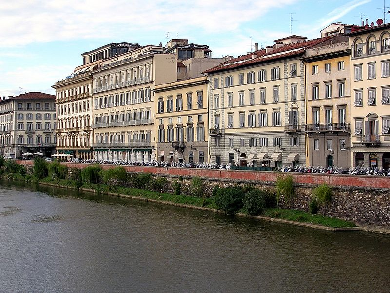 Hotels and shops line the Arno.