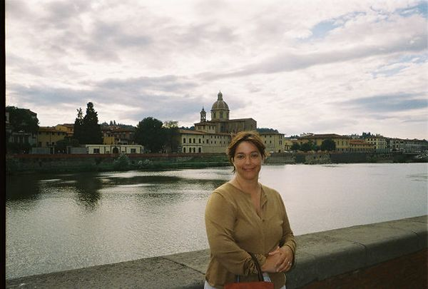 Angie standing on the banks of the Arno.