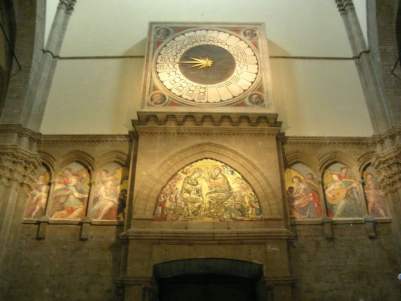 West wall clock inside the Duomo.  No flashes were allowed - the pictures do not do the beauty justice.