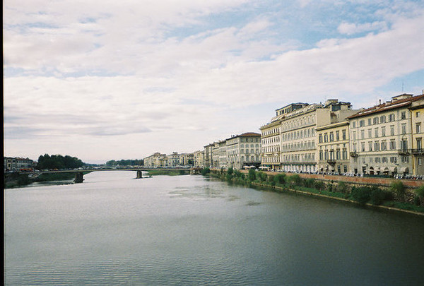 The River Arno flows through Florence.  Florence, located in north central Italy, is famous for being the birthplace of the Renaissance. The Renaissance, a period that began in 1300 and lasted 300 years, attracted some of the greatest artists, writers, and sculptors in history to Florence.