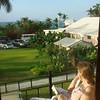 Cindy peace'n out on the deck, Orange Hill Beach Inn
