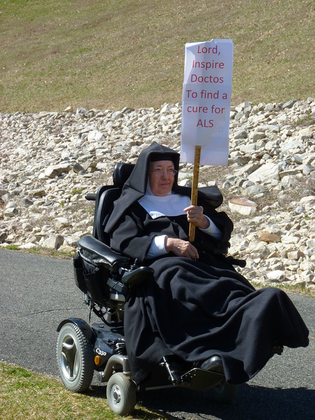 Sister Gemma Maria with her special sign and her praying hands!