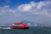 Turbo Jet Macau ferry boat traffic in Victoria Harbor, Hong Kong, China, Asia.