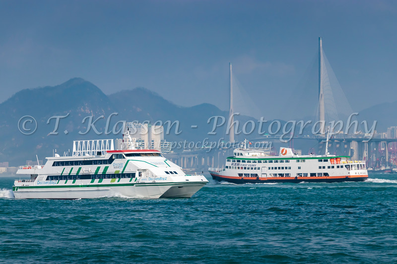 Ferry boat traffic in Victoria Harbor, Hong Kong, China, Asia.