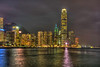 The city skyline of tall buildings illuminated at night on Hong Kong Island,  Hong Kong, China, Asia.