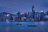 The Hong Kong Island skyline illuminated at night from Tsim Sha Tsui, Kowloon, Hong Kong, China, Asia.
