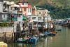 Houses on stilts and boats in the fishing village of Tai O on Lantau Island, Hong Kong, China, Asia.