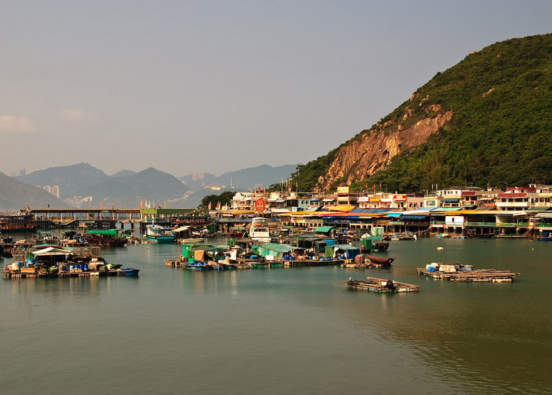 Boats docked by the pier at Sok Kwu Wan