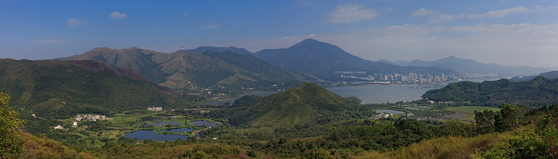 "This is a bird's eye view of the whole Luk Keng (鹿颈), and is a pano with 3 shots stitched together.  See the ""original"" (still much reduced) to appreciate the scene more.  The high-rises at the far right are in Shenzhen and not Hong Kong!"