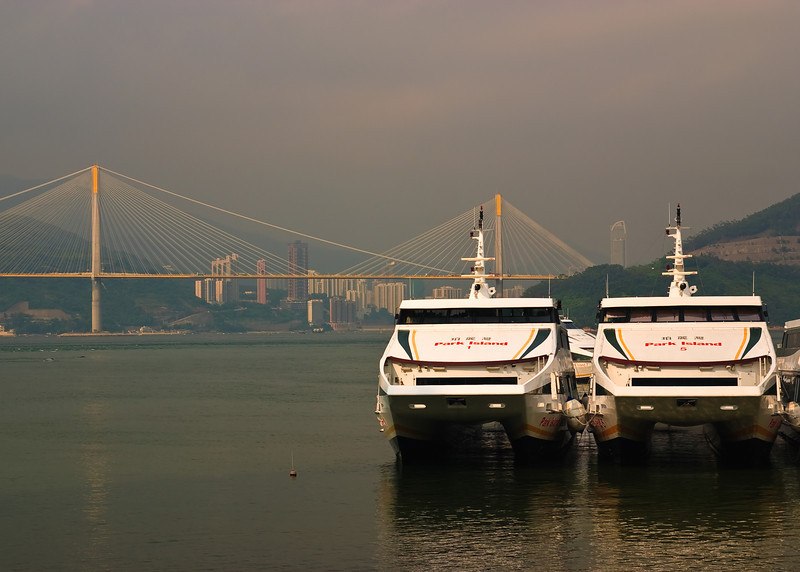 Boats docked at Northern end of Ma Wan.  The bridge in the background connects Tsing Yi Island to Tsuen Wan.