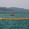 Rower practicing offshore from Sai Kung