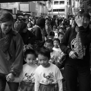 Young lion dance participants and their proud mothers