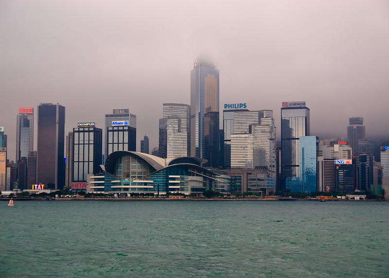 View of the Wan Chai District on Hong Kong Island. The building with the curved roof is The Hong Kong Convention and Exhibition Center.