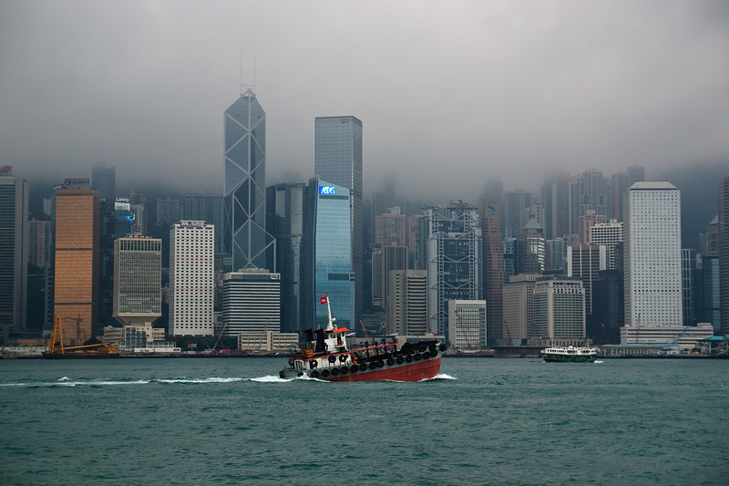 Boat in Victoria Harbor.  Buildings in Admiralty and Central are in the background.