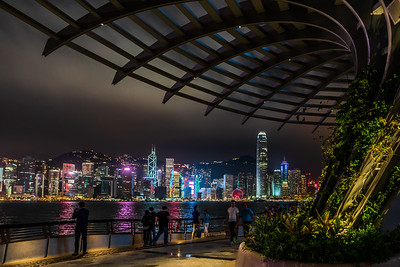 View of Hong Kong Island skyline from Avenue of Stars at night.