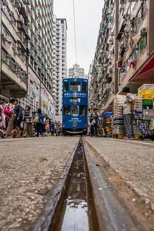 Tram making its way through Chun Yeung Street Market.