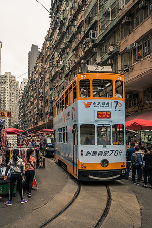 Tram making its way through Chun Yeung Street Market.