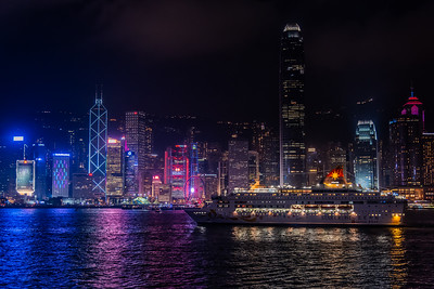 Cruising by Hong Kong city skyline.