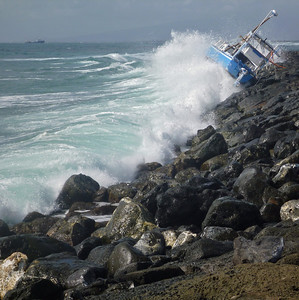 Capsized Boat During Big Ocean Swells