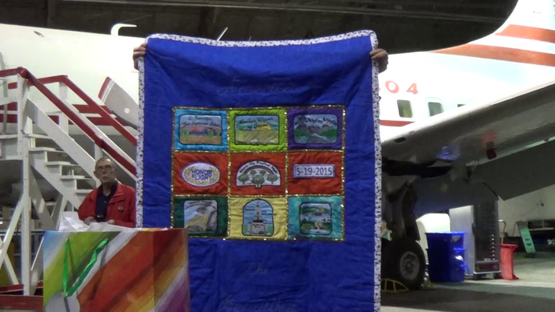 The wife of a WWII veteran who flew on one of our flights last year has been making a small quilt for the oldest veteran on each flight. This short clip is a cute story about the first quilt she made for the flight her husband went on.