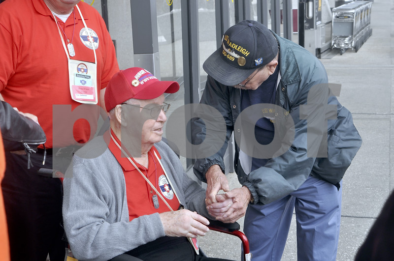 -Messenger photo by Chad Thompson<br /> <br /> Lloyd Gochenour, a World War II veteran from Humboldt, is greeted by a veteran in Washington, D.C. Saturday. Gochenour and two of his brothers served in World War II. He was one of only six World War II veterans on the Brushy Creek Area Honor Flight.