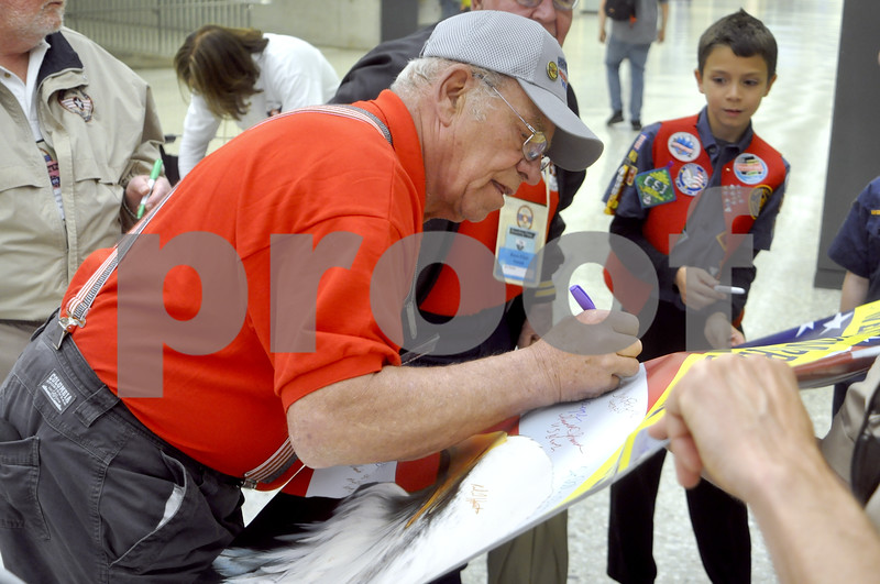 -Messenger photo by Chad Thompson<br /> <br /> Thomas Underberg, of Carroll, and a Vietnam veteran, signs a poster for boy scouts in Washington, D.C. Saturday.