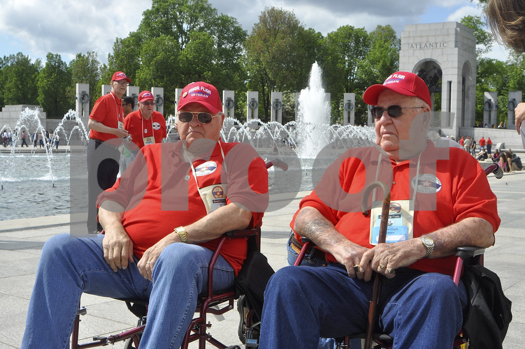 -Messenger photo by Chad Thompson<br /> <br /> Veterans Mike Graham, a Vietnam veteran, and Leo Staton, a Korean War veteran hang out at the World War II Monument in Washington, D.C. Saturday. Graham also served during the Gulf War as a crash and rescue specialist.