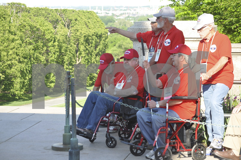 -Messenger photo by Chad Thompson<br /> <br /> Veterans reminisce at Arlington National Cemetery while waiting to observe the Changing of the Guard in Washington, D.C. Saturday.