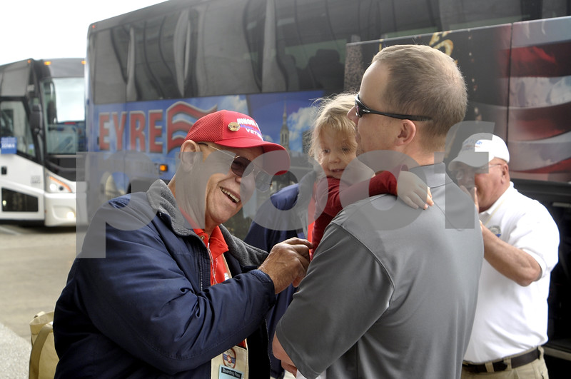 -Messenger photo by Chad Thompson<br /> <br /> Walter Thomas, a Korean War veteran from Carroll, is all smiles as he meets his granddaughter, two-year-old Olivia for the first time in Washington, D.C. Saturday.