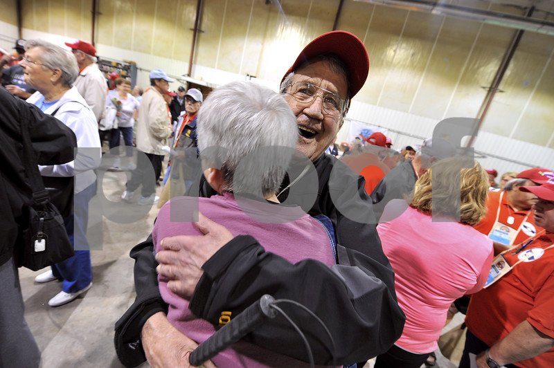 -Messenger photo by Hans Madsen<br /> <br /> Vietnam Army veteran Gary Michael, of Fort Dodge, gets a hug from his sister, Nancy Herzberg, of Fort Dodge, as he gets ready to depart for Washington D.C. on the Brushy Creek Area Honor Flight Saturday morning.