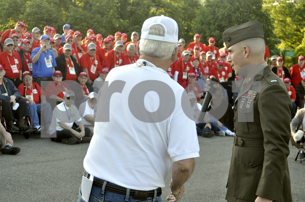 -Messenger photo by Chad Thompson<br /> <br /> Ron Newsum, chairman of the Brushy Creek Area Honor Flight board, and Lt. Matt Rojo, of the U.S. Marine Corps speak to the veterans at the U.S. Marine Corps War Memorial in Washington, D.C. Saturday evening.