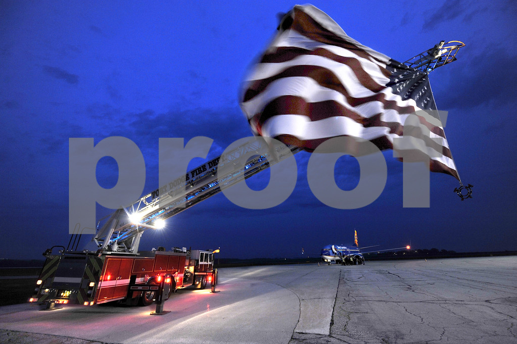 -Messenger photo by Hans Madsen<br /> <br /> Courtesy of the Fort Dodge Fire Department, the U.S. Flag flies over the tarmac at the Fort Dodge Regional Airport Saturday morning as the Brushy Creek Area Honor flight boards their craft for Washington D.C.