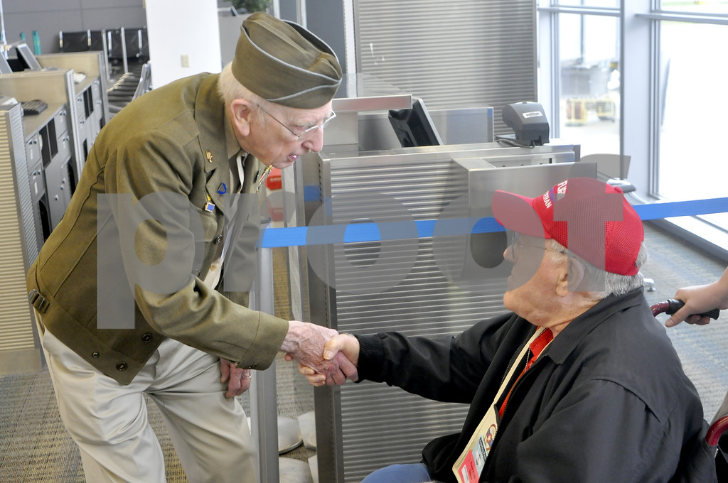 -Messenger photo by Chad Thompson<br /> <br /> Dick Graff, a World War II veteran from Popejoy, Iowa, shakes the hand of Joe Sippel, who served in the U.S. Navy.