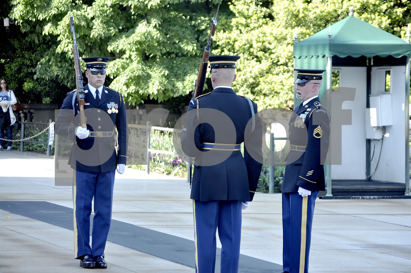 -Messenger photo by Chad Thompson<br /> <br /> The relief commander and the relieving sentinel meet the retiring sentinel in the center of the matted path in front of the Tomb of the Unknown during the Chaning of the Guard ceremony in Washington, D.C. Saturday.