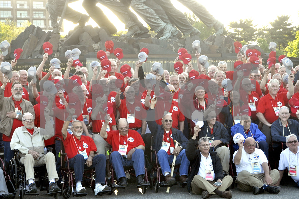 -Messenger photo by Chad Thompson<br /> <br /> Area veterans raise their hats in the air at the U.S. Marine Corps War Memorial in Washington, D.C. Saturday.