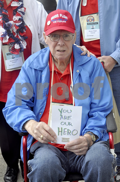 -Messenger photo by Chad Thompson<br /> <br /> Robert Varner, of Woden, holds a sign given to him by total strangers in Washington, D.C. Several people whom the veterans had never met walked up to them and thanked them for their service Saturday.