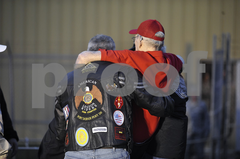 -Messenger photo by Hans Madsen<br /> <br /> Veteran Peter Nielson gets carried into the terminal hangar by several other veterans including Gregg Warland, left, of Fort Dodge, as he arrives Saturday morning for the Brushy Creek Area Honor Flight to Washington D.C.
