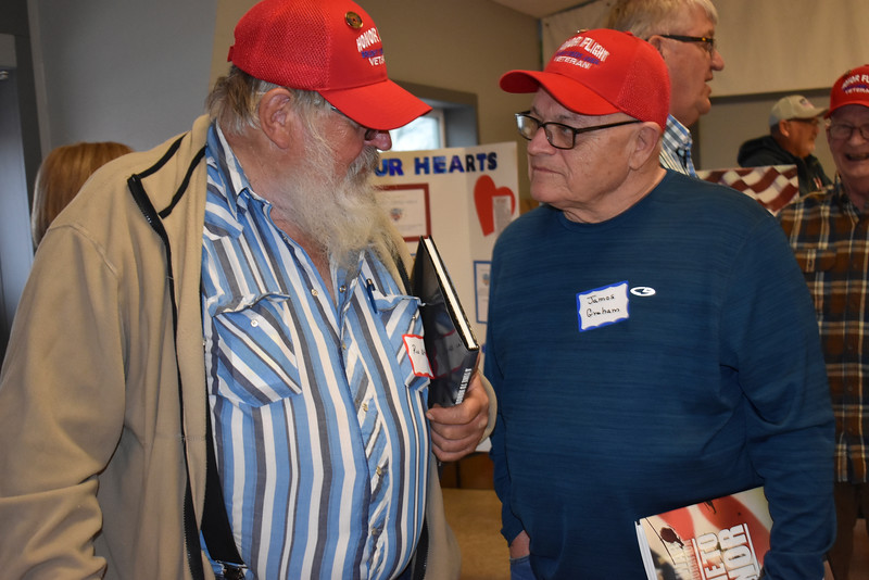 -Messenger photo by Chad Thompson<br /> <br /> James Graham, a U.S. Air Force veteran from Webster City, right, visits with Rex Utech, a U.S. Marine Corps veteran from Williams during the 16th Brushy Creek Area Honor Flight banquet at the Webster County Fairgrounds Wednesday night.