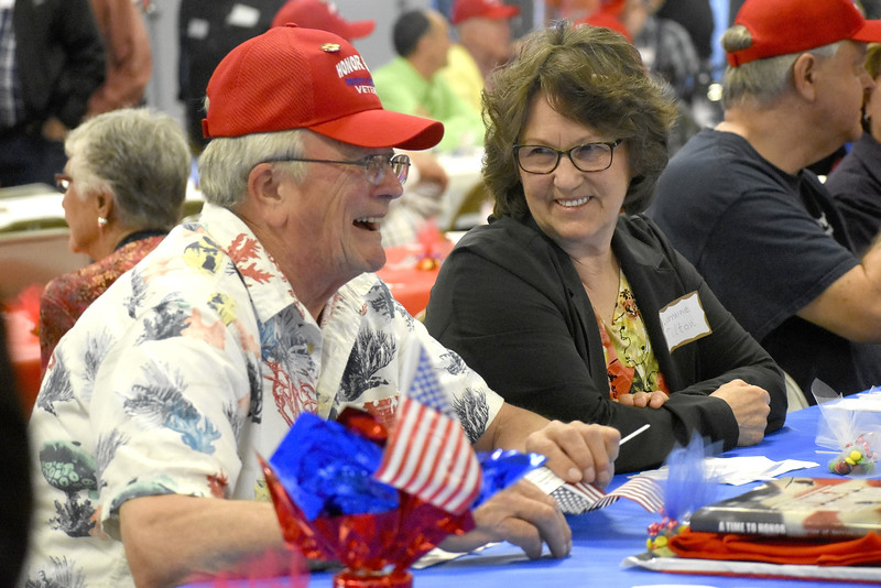 -Messenger photo by Chad Thompson<br /> <br /> Ken Tilton, a U.S. Army veteran, left, and his wife Lorraine Tilton, of St. Ansgar, share a life during the 16th Brushy Creek Area Honor Flight Wednesday night at the Webster County Fairgrounds.